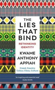 The book cover for The Lies That Bind, with alternating colorful fabrics in the background behind the book title