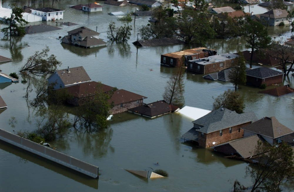 Several blocks of houses submerged up to their rooftops in floodwaters