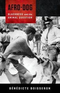 The book cover of Afro-dog, with a black and white photograph of a police dog biting a Black civil rights protestor