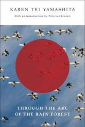 The book cover for Through the Arc of the Rain Forest by Karen Tei Yamashita featuring an image of pigeons in flight foregrounded by a semi-transparent red circle.