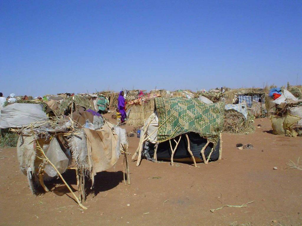 Make-shift refugee tents in arid landscape
