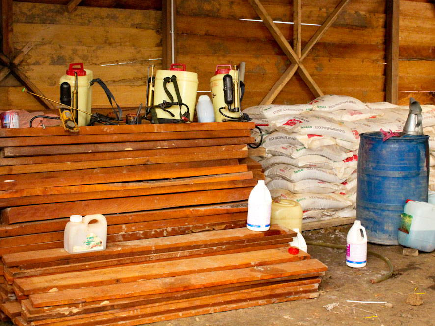 Timber for construction, fertilizer and pesticides in a shed