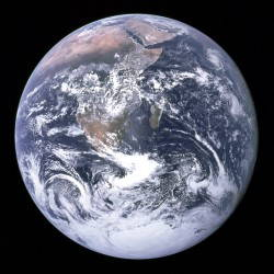The Earth from space; a ball of blue and white swirls.