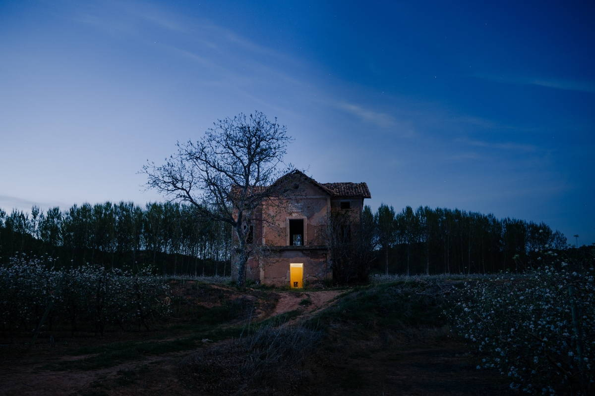 Ruins of old house at night.