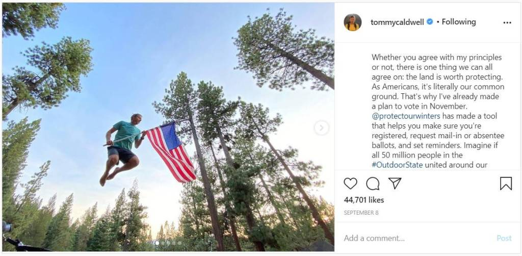 Man jumps high in the air holding an American flag. Instagram post calling for environmental nationalism.