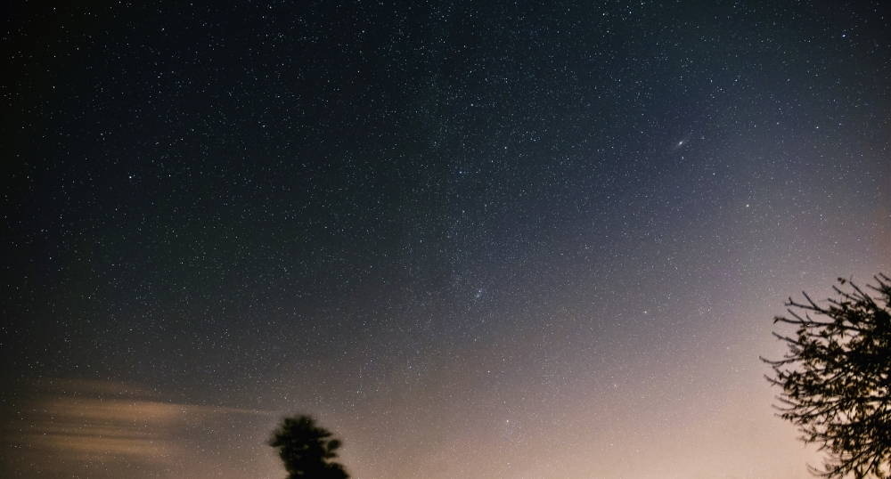 Astrophotography of a star-filled night sky with the constellations Andromeda and Perseus.
