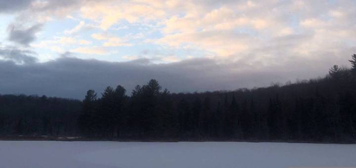 Clouds over frozen lake