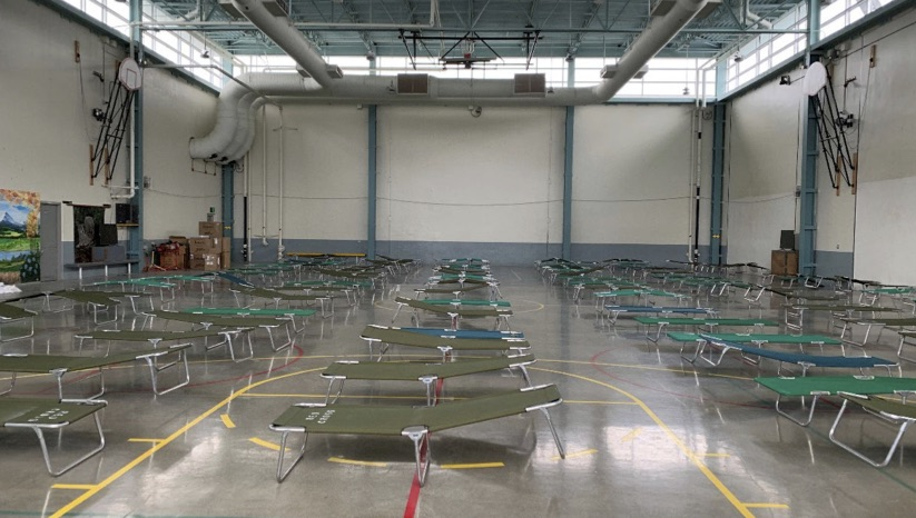 cots in an empty room