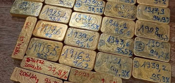 Malagasy gold bars with red and blue writing on them