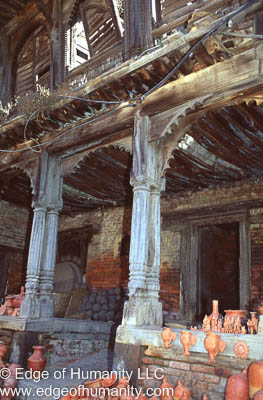 Nepal - Bkaktapur: Pottery drying on ancient building steps.