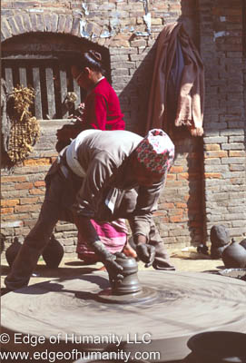 Man working pottery in the Town Square. Bkaktapur, Nepal.