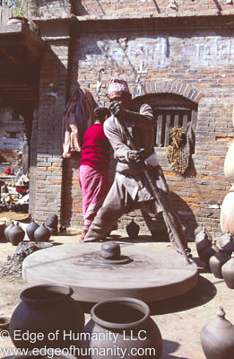 Nepal - Bkaktapur: Man working pottery in the Town Square.
