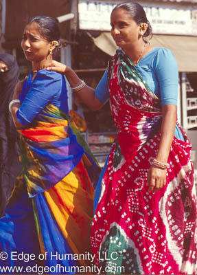 Two women wearing very colorful sarees - India.