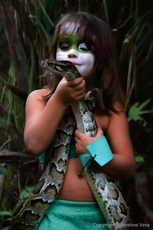 CHILD TALKING TO A SNAKE merges the animal kingdom with humans in an imaginary world created by the artist Valentine Vera