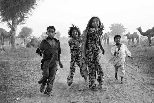 Children running dusty roads of Rajasthan Nagaur, Rajasthan, India