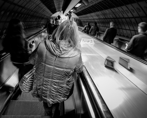Commuters Waterloo Underground Station, London I am always fascinated by commuters; this was taken towards the end of the morning rush hour when the crowds of commuters had thinned out. The center of attention was the lady in front of me.