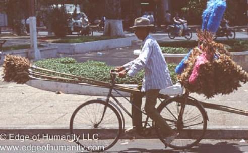 Man transporting goods on bicycle - Vietnam.