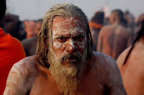 This sadhu was warming up as the winds were biting. Look at his eyes; earlier he had been smoking grass to warm up his body.