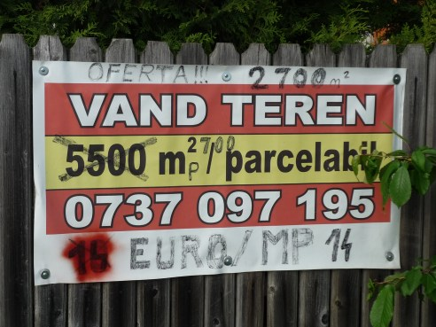 Phase 5 – first signs of change: the Euro overcomes the local currency. The initial surface of lands had been turned into smaller parcels and sold piece by piece. It's no longer the time to sell large parcels. The advertisement gets more professional, which in this stage means more colored and printing on a plastic foil. Notice the handwritten variations of the land surface and price.