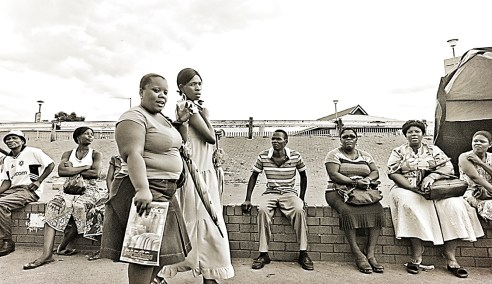 """The downtown terminal"""" This is a scene at the taxi rank in Rustenburg, South Africa. I enjoyed the diverse range of emotions expressed from the bystanders of this image when they glimpsed me shooting!"""