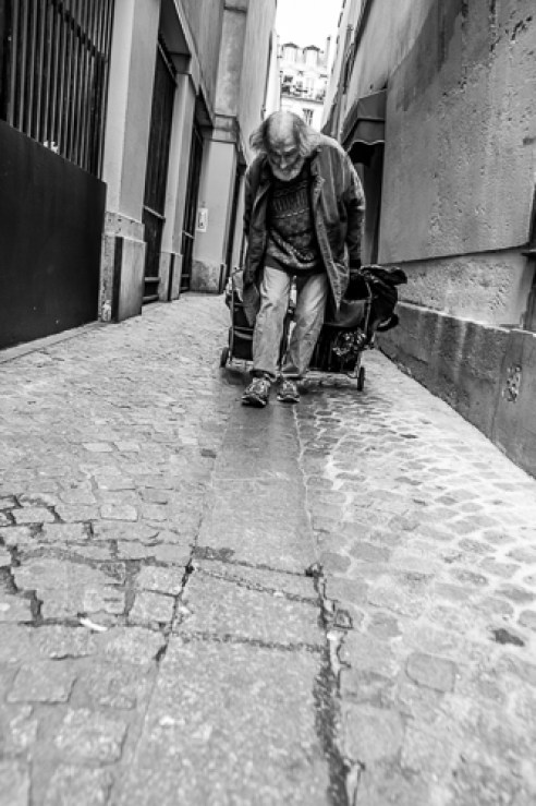 He walks the same route in Paris everyday, with his broken back.
