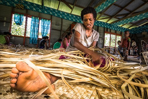 Weave: Sisilia knows it's all in the leaves as she weaves a traditional Fijian mat from locally grown voivoi, a species of pandanus. With deforestation out of the question, villages along the lower shore of Natewa Bay partake in various crafts, traditions and business ventures to support themselves economically. Every Wednesday in Muana village, women flock to the community hall to practice the art of handicraft... and gossip.