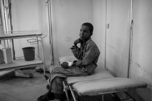 - I came across this young boy in an IDP (Internally Displaced Persons) camp in Mogadishu, Somalia while documenting another project. Due to my affiliation with Smile Train, I was able to help facilitate his corrective surgery with the help of the head surgeon at Medina Hospital in Mogadishu. This image was taken an hour before his surgery.