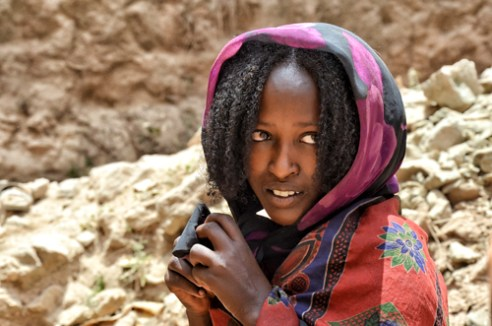 "Young Borana woman near a ""singing well"". Southern Ethiopia."