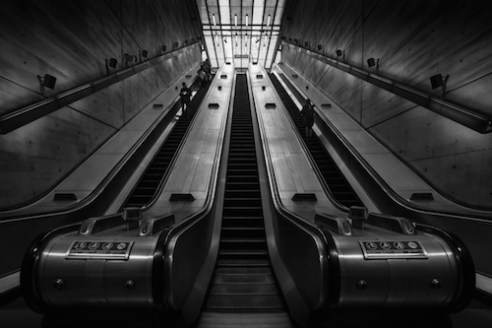 One Up The tall escalators on the Jubilee Line reach up towards the light at street level. The modern stations of the London Underground network have some fantastic chrome looking architecture, ideal for black and white photography.