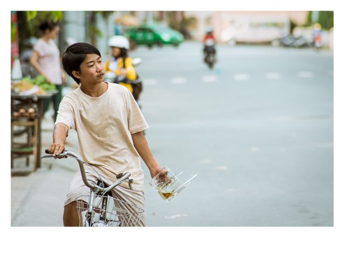 A tea dealer in the streets of Can The, Mekong River, Vietnam