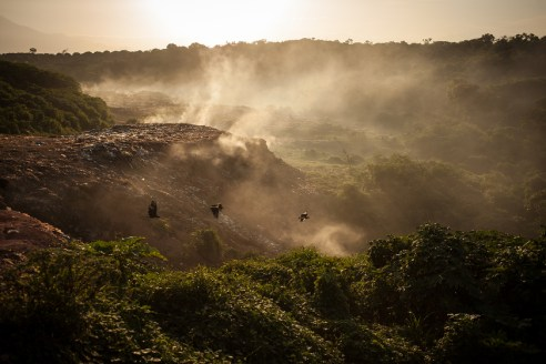 Vultures are flying by as smoke ascends from a now abandoned part of Tapachula's rubbish dump, which caught fire in January 2015 and could not be extinct completely until now.