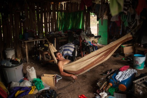 Sotero is taking a rest in the hammock in his home in the Linda Vista settlement after a day of work. Originally from the aldea Vista Frontera in Guatemala's municipality Tajumulcu, Sotero today takes care of the small catholic church, the community has built with recycled materials. He is one of the inhabitants of the settlements who have gained Mexican residency which allows him to cross the border legally to travel to Guatemala and visit his family.