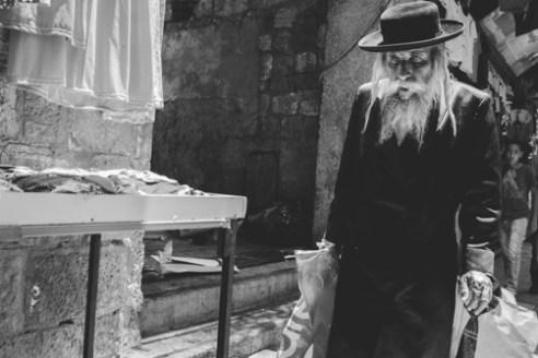 Man Walking Old City June 15, 2015 - An Orthodox Jewish man walks though Jerusalem's Old City.