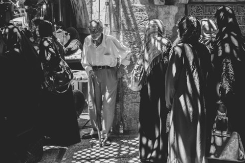 Man Muslim Quarter June 15, 2015 - An elderly man watches passers-by in the Muslim Quarter of Jerusalem's Old City.
