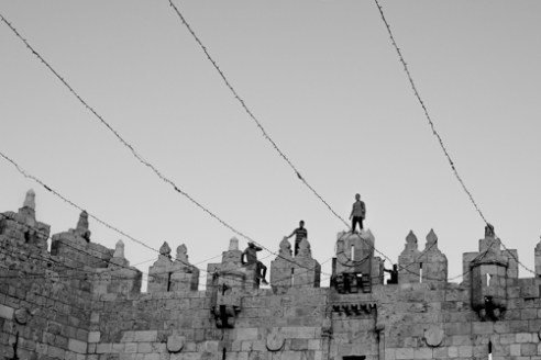 Damascus Gate Celebration June 16, 2015 - Young men stand on top of Damascus Gate Jerusalem in celebration of the holy month of Ramadan.