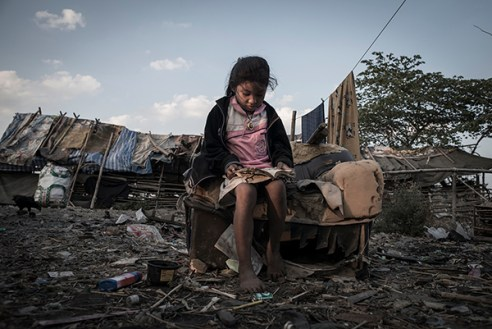 Mae Sot, Thailand; February 6th, 2014. A garbage dump is the home and workplace for a group of Burmese 'Karen' refugees and their children.