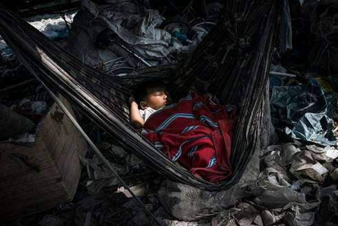 Mae Sot, Thailand; February 2014. A baby sleeping in the middle of the dump