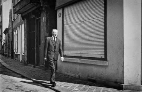 Man walking alone in a street of Le Havre - France (1976).