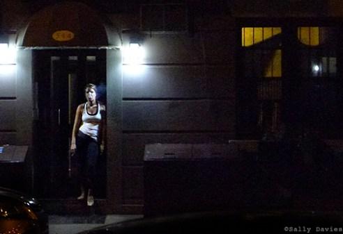 Woman smoking in Doorway, East Village, NYC