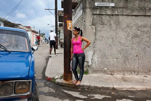 A girl waiting on a street in Regla, near La Habana.