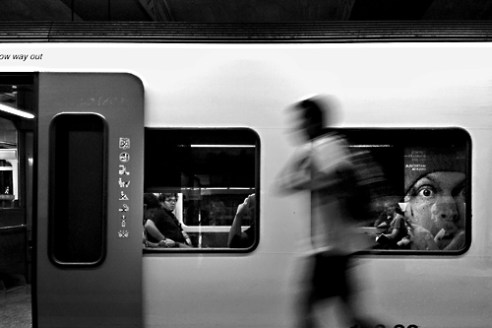 Man running to catch the subway train. Barcelona, Spain