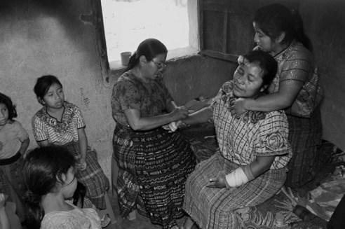 Berta Navichoc, healing Marta Mendoza Damian after she was badly hurt in an accident. Santiago Atitlán, Guatemala
