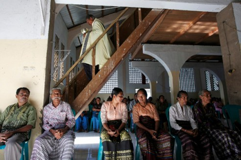 Worshipers during Sunday Mass. The village is strongly Catholic with the first missionary, a Dutchman, arriving in the mid-19th century.