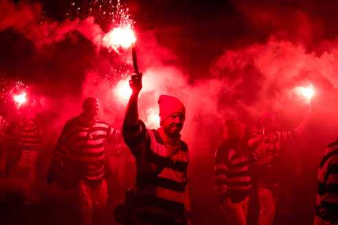 Flares are lit by members of the Cliffe Bonfire Society.