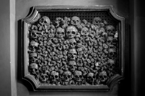 PIAZZA SANTO STEFANO. A detail of the Church of San Bernardino alle Ossa (The Bone Chapel), a small side chapel decorated with numerous human skulls and bones