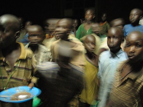 Gulu, Uganda, 2004. Boys line up for supper at St Joseph's College in Layibi. The boarding school has a high occupancy as parents seek safe shelter during the war with the Lord's Resistance Army.
