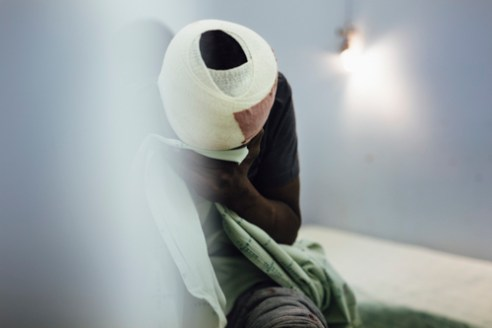 A man sits on a stretched bed and cries. The nurse has just finished dressing a wound on his head. When asked about the accuracy of the statistics, a doctor working in the casualty was quick to note that the statistics are far from the truth. As the hospital of Katutura suffers from a lack of manpower, the staff has to prioritize treating the patients over counting them.