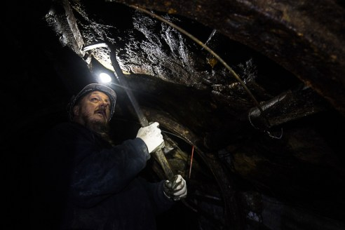 Richard Daniels testing the overhead conditions in the mine, Hopewell Colliery.