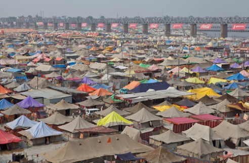 "_""Kumbh Nagar"" the huge tents camp for the pilgrims in Allahabad during the religious festival of Maha Kumbh Mela (Uttar Pradesh, India)."