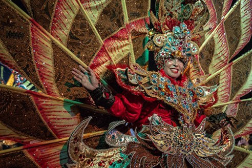 SURAKARTA-INDONESIA, April 29 2015. An elaborately costumed dancer celebrates World Dance Day at a 24-hour event on Slamet Riyadi protocol street in Surakarta City. First established in 1982, World Dance Day was created by the International Dance Council as an opportunity for countries to recognize their unique history of dance, as well as to encourage the public to engage in traditional and contemporary styles. The ninth year of the event in Surakarta City served as a showcase for Javanese dance and included a performance of Tari: Nafas dan Kehidupan (Dance: Breath and Life).